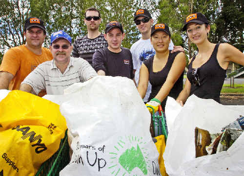 Chris Eggersdorf (left), Steve Toms, Jason Pitt, Michael McLean, Lachlan Smith, Jessie Smith and Alexandra Smith, employees from Woolworths and BWS in Lismore helping to clean up Australia.