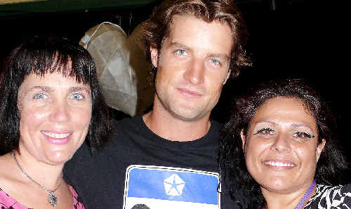 Actor Axle Whitehead (centre) makes a star appearance at the Byron Bay Film Festival with festival director J'aimee Skippon-Volke (left) and Jeni Gonzalez.