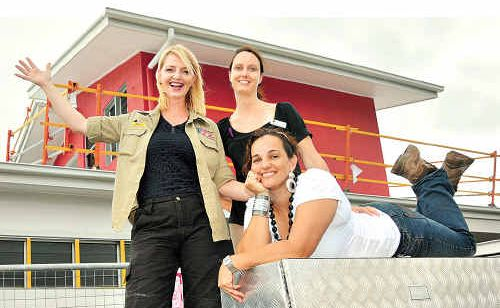 Buildmore Group's Sam Sheppard with Nicki Trenham and Radmila Desic outside the finished showcase home, built entirely by women.