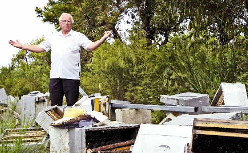Haydon Burford, of First Sun Employment, was stunned when he arrived at Evans Head to find these beehives destroyed by vandals on trail bikes.
