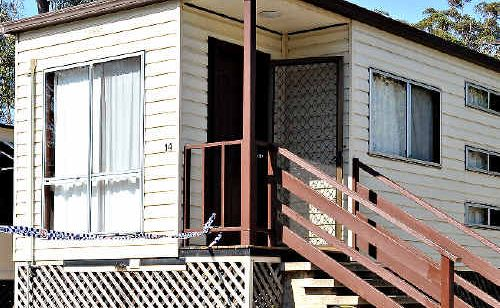 Police cordoned off a villa at Coffs Harbour's Clog Barn Caravan Park following the alleged assault.