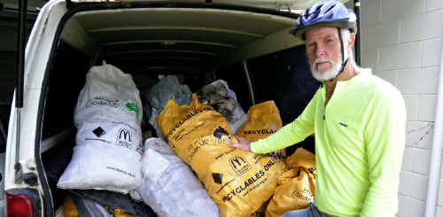 Bruce Meredith of the Coffs Harbour Bicycle Users Group with the 300kg of rubbish collected by members of the group on Clean Up Australia Day.