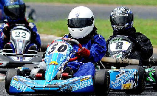 It was a close battle between Michael Dwyer (front) and Chris Burley (8) in the junior national lights at Lismore Kart Club on Sunday, with Dwyer eventually winning the round from Burley in second and Jacob Jolley (22) in third.