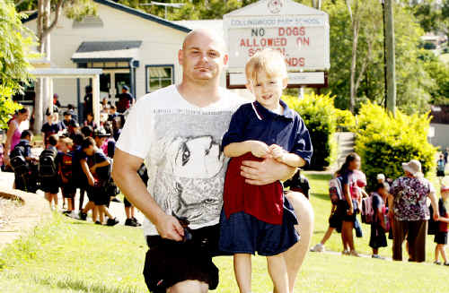 Andrew Reseigh with his step-daughter Ebony Hutchinson in Year One at Collingwood Park School, is pleased that the nearby corner shop is refusing to sell sugary treats to students without parental supervision. Photo: Sarah Keayes MA1010AA
