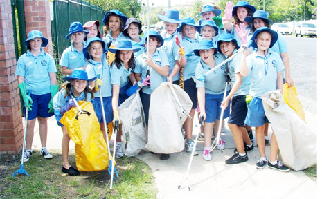 PICTURED are Byron Bay Primary School student cleaning up outside the school's main gate.