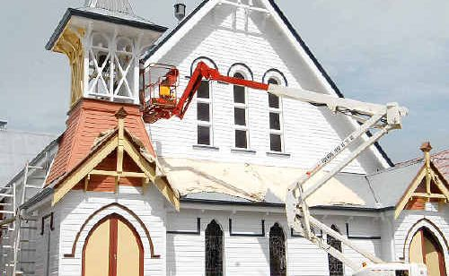 St Paul's Uniting Church is changing its heritage colours to a white coat to help it stand out.