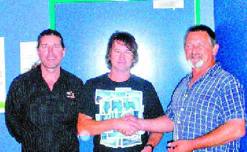 FOR THE BOYS: Peter Lea hands over a cheque to help fund the Building Bridges program to headspace youth worker, Gary Maher and Mick Bettison from PCYC's Youth on the Go.