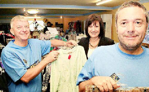 Richmond MP Justine Elliot and The RePSYCHlers Op-Shop supervisor Phillip Kine and worker Tony Dick at the store's official opening yesterday. Photo: Blainey Woodham D125288