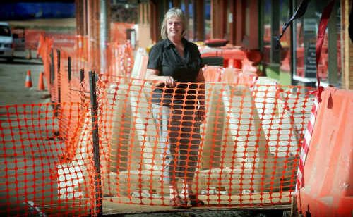 Annie Dodd of the Alchemy Cafe stands in the middle of the South Grafton beautification work.