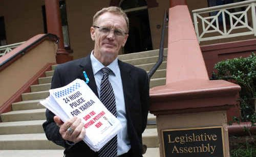 MP Steve Cansdell outside NSW Parliament with the petition.