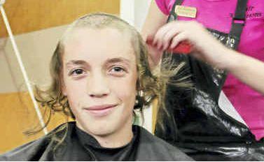 Year 10 student Jake Reid gets the chop from Hair Kreations stylist Nicola Watt.