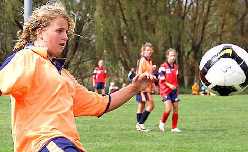 North Coast Football's under 16 girls right-back Jodi Cooper clears the ball on Saturday during the third round of the Northern NSW State league Cup in Armidale.