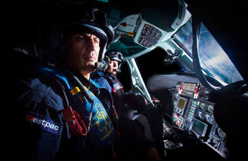 Rescue helicopter pilot Marty Hanna and veteran crewman Michael Kerry ready for take-off on a night mission.