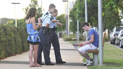 Police speak to Matthew Strang outside Grand Central in Dent Street on December 21.