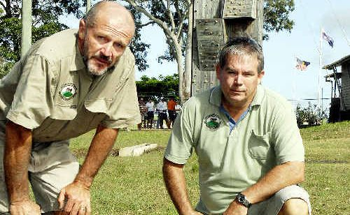 Glendyne teacher Mark Macrae (left) and principal Dale Hansen inspect one of the mauled sheep at the school.