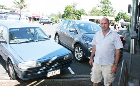 Wash House Laundry owner Bob Evans is not impressed with loss of parking spaces outside his business.