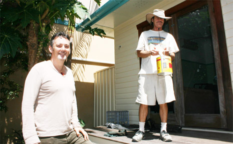 Paul Spooner in front of the Fletcher Street Cottage with volunteer painter, David Kennedy.