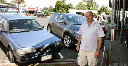 Parking problems: Bob Evans, from Wash House Laundry in Marvel Street, Byron Bay, is not impressed with the newly-marked parking spaces outside his business.