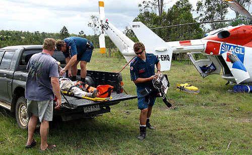 Paramedics prepare to airlift the injured man to Royal Brisbane.