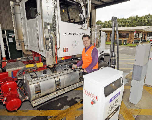 Fill it up: Councillor Ben Smith pumps B20 Biodiesel fuel consisting of beef and mutton fat combined with soy beans and conventional diesel into one of the Council's 100 vehicles.