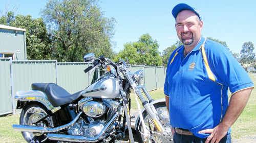 Warwick Rotary president Bryan Stephens with the 2010 Softail Standard Harley Davidson.