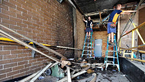 BURNT OUT: The loading bay behind the Commonwealth Bank was set alight on Wednesday night, causing tens of thousands of dollars of damage and closing businesses yesterday.