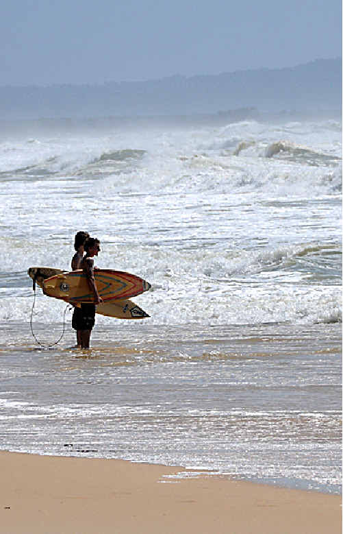 DANGEROUS CONDITIONS: Surfers checked out the choppy seas at Rainbow Beach yesterday and kept their boards dry.