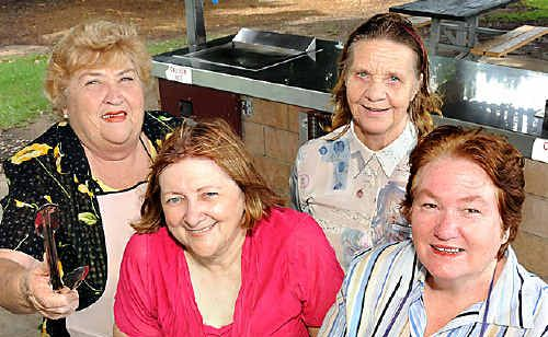 NICE NEIGHBOURS: Gympie tenant group president Gail Thomas, Marie Farenden, Sandy Morgan and Wide Bay Burnett regional tenant group president Pam Knight invite everyone to a free sausage sizzle for Neighbour's Day in Gympie.