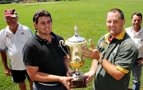 FINALS FEVER: Harlequins' Peter Kross (left) and Wests' Neil McKean hold the silverware they will play for this weekend, while Gympie Cricket president Bob Blackburn and major sponsor Brendan Paterson of Cooloola Civil Constructions look on.