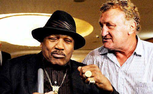 Joe Bugner (right) greets US boxing legend Joe Frazier who is in Australia for Bugner's 60th birthday charity dinner.
