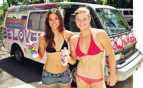 Cindy Santini, from California, and Leah Dawson, from Hawaii, have been getting pro surfers to spray paint their van to support the fight against breast cancer.