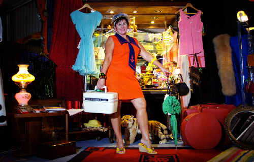 Time warp: Stacy Star, of the Vintage Palace, shows off her range of vintage clothing and furniture available in her backyard shed in Eureka.