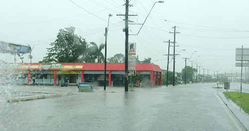 HEAVY rain pummels the Big Bear shopping centre on Harbour Road at daybreak yesterday with drains struggling to cope.