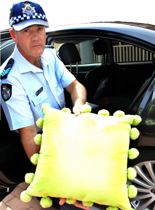 Not good enough: Warwick Police Traffic Branch officer in charge Sergent Ross Waugh has warned pillows won't save your baby if involved in a car crash.