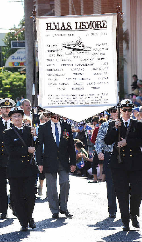 ANZAC DAY 2009: The banner of HMAS Lismore is carried by TS Lismore representatives.