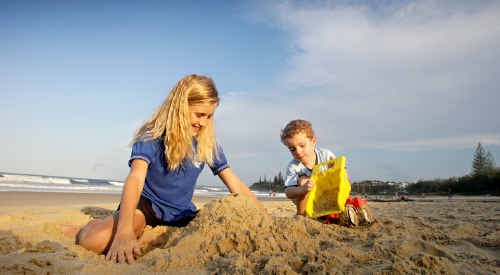 Ruby Southwell, 11, and Harrison Thiele, 3, make the most of beautiful weather to play on Alexandra Headland beach yesterday. Forecasters are tipping wet weather for at least the rest of the month.