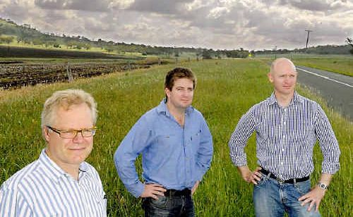 Ambre Energy executives (from left) Michael van Baarle, Matthew Adams and Neil McGregor stand in front of the site proposed for the AmbreCTL project.