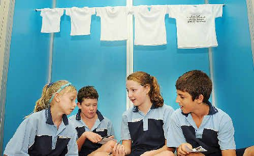 Cara Feain-Ryan (left),11, Harrison Leslie,11, Hannah Isaac,12 and Angus Cannon,11, of St Joseph's School at Alstonville take part at the Caritas Millennium Development Goals and You Exhibition at Lismore Workers Club.