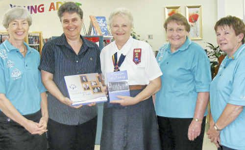 Memories: Trefoil Guild president Deborah Barlow, librarian Samantha Shelbourn, Trefoil Guild members Helen Madsen, Winsome Anderson and Ann-Maree Clark with the new books marking the 100 years of Girl Guiding.