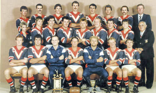 The Warwick Cowboys reserve-grade side won the club's first premiership in 1986. (Front, from left) Michael McVeigh, David Osborne, Simon Mitchell, captain Peter Watt, coach Dave Manthey, Paul Doyle, Darryl Aspinall, (middle) strapper Denise Beattie, Robert Dunstar, Noel Loudon, Tony Small, Rod Neal, Peter Roser, Peter Cresswell, Murray Croft, patron Tony Maroon, (back) Mick Cantwell, Mal Beattie, Steve Scotney, Glen Whitton, Brian Dunne, Lou Marshall, Robert Beattie, sponsor Paul Lysaght.