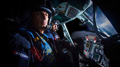 Life Saver Rescue Helicopter pilot Marty Hanna (front) and veteran crewman Michael Kerry ready for take-off on a night mission.Photo by Adam Hourigan.