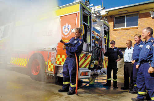 Testing the hoses on their new fire truck are Lismore fire station crew (from left), Captain Brett Lowden, senior firefighter James Connors, Superintendent Chris Fabri, senior firefighter Greg Marker and station officer Ian Grimwood.