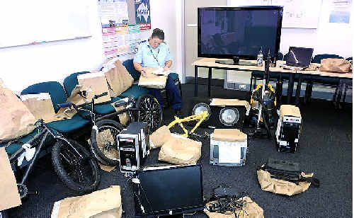 Senior Constable Kelly MacDonald at Lismore police station with some of the items recovered during recent raids.