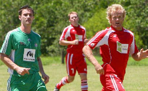 Whitsunday Miners forward Tyson Masters and Wanderers' Greg Willey in a men's premier division pre-season game.