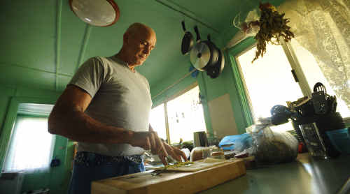 NOW: Peter Casson prepares a healthy lunch for himself.