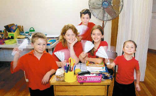 Vistara students resort to old-fashioned means to cool down, having turned off all electrical items in support of Earth Hour. From left are, Isaac Fuad, 6, Lilli Allan, 11, Julius Wassenas, 10, Jasmine McGuane, 10, and Elena Matiussi-Pimm, 5.