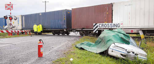 An Oakenden woman died when the Commodore she was driving and a freight train collided just south of Mackay yesterday.