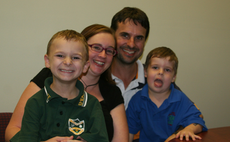 HELPING HAND: Julie and Gary Currie, with their songs Thomas, six, and Dylan, four, are campaigning for greater support for families dealing with autism.