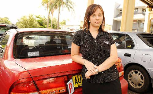 Chloe Sten, of South Lismore, was shaken when the passenger side door of her car was hit by a rock late at night as she was driving along Ballina Road in Goonellabah.