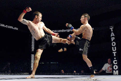 Andrew Beverage (left) and Luke Morris battle it out during the Underground MMA Cage Fighting tournament at the Lismore Workers Club on Saturday night.